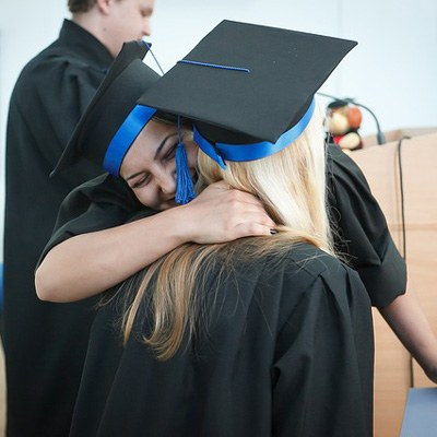 Two friends celebrating graduation
